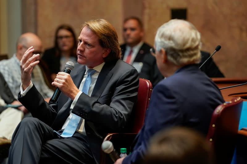 Former White House counsel Don McGahn sits with Senate Majority Leader Mitch McConnell while speaking to a gathering of the Federalist Society at the State Capitol in Frankfort