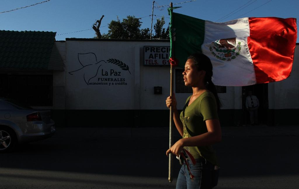 Mexicans marched against drug gang violence in Ciudad Juarez, in Mexico's Chihuahua state, where at least 14 people were killed on June 23, 2018