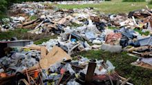 Travellers leave bath tubs, fridges and mattresses behind among 250 tonnes of waste after being evicted from field