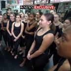 Michelle Obama surprises a dance class at her former high school