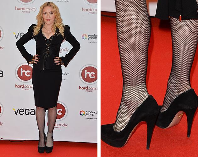 madonna nurses an injured foot at the hard candy fitness club opening in toronto. Black Bedroom Furniture Sets. Home Design Ideas