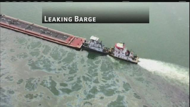 Authorities work to contain oil spill