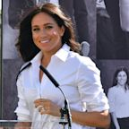 Meghan 'set up odd paparazzi photo' before meeting Harry, book claims