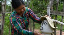 Cambodian farmers deploy scarecrows to ward off virus