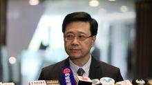 Special Report: Hong Kong's top cop overshadows embattled leader Lam as China cracks down