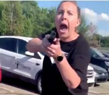 A white woman who pointed her gun at a Black woman and her 15-year-old daughter outside a Chipotle has been arrested