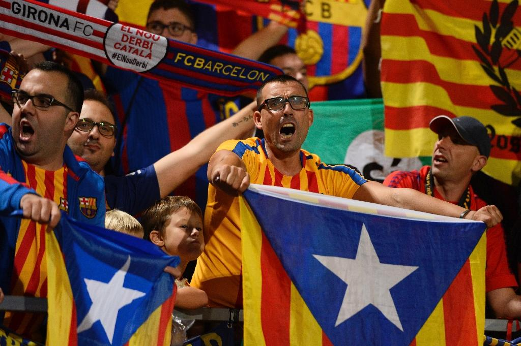 Catalonia pays more into Spanish government coffers than it receives in return, an issue that has fuelled separatist sentiment in the region in the run-up to a contested independence referendum (AFP Photo/Josep LAGO)