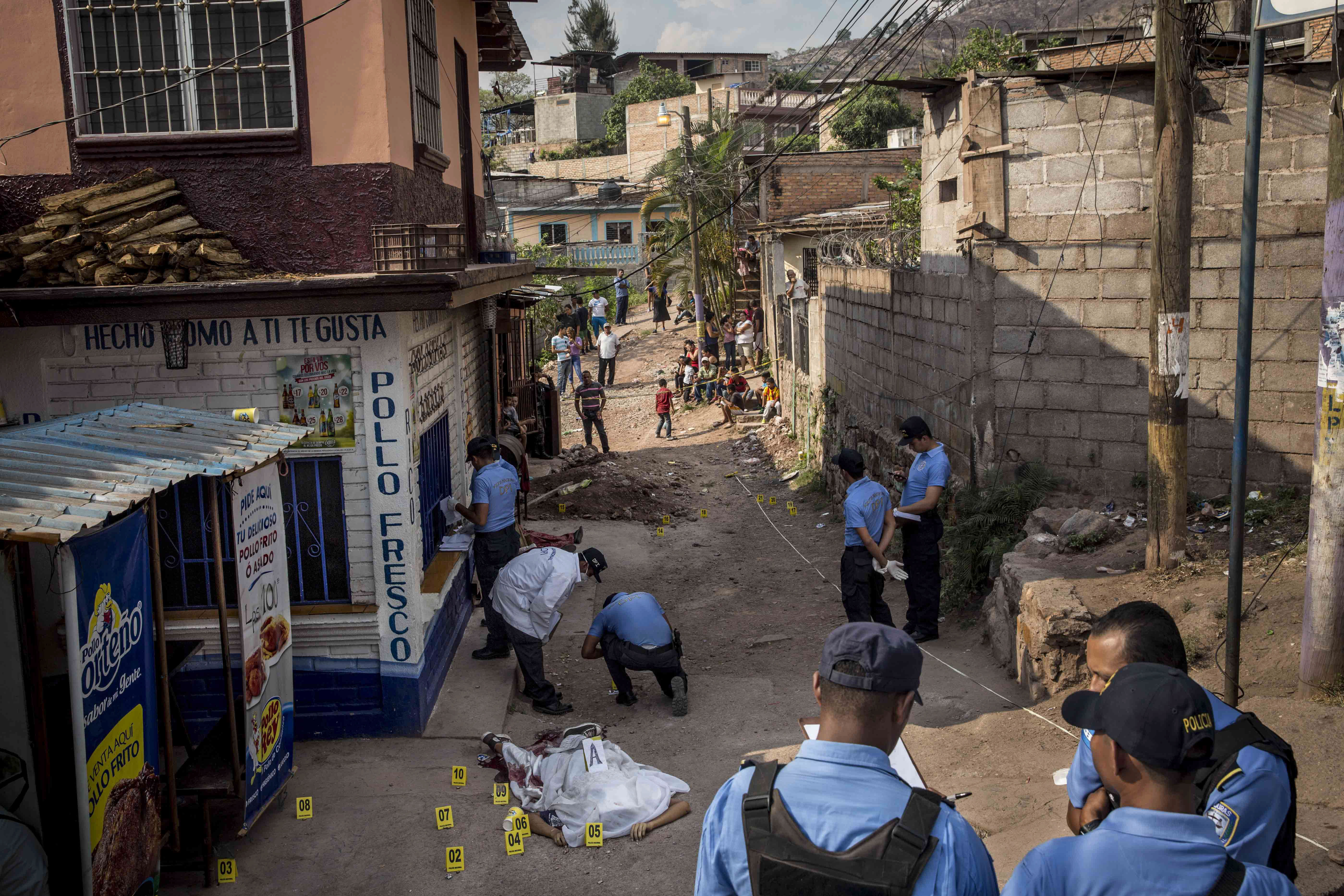 <p>The crime scene of the murder of two brothers, Carlos Amador 22, and Edwin Amador, 20, shot in cold blood during broad daylight in the streets of the Suyapa neighbourhood in Teguciaglpa, the capital of Honduras. (Photo: Francesca Volpi) </p>