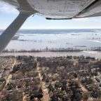 More floods loom as high river waters recede in Midwest