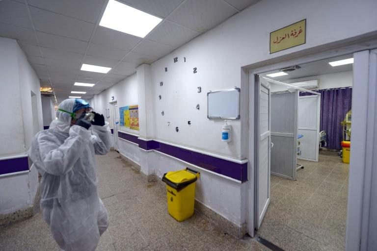 Iraq's first novel coronavirus case is an Iranian studying in a Shiite seminary in the city (AFP Photo/Haidar HAMDANI)
