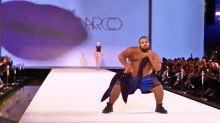 Plus-size male model kills it on the runway with sexy striptease