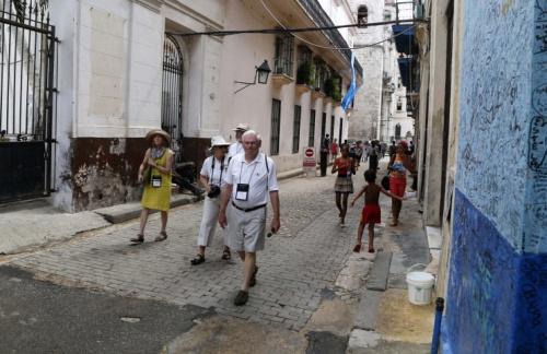 Tourists walk in Havana, Cuba