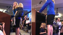 Viral photo shows newly elected congresswoman's daughter playing at her feet during victory speech: 'So real. So human. So great!'