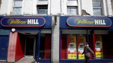 William Hill reins in profit expectations, warns of U.S. losses