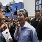Ex-Hong Kong lawmaker goes into exile, plans to travel to UK