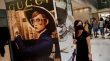 Gucci owner Kering halts spending in China on virus fears