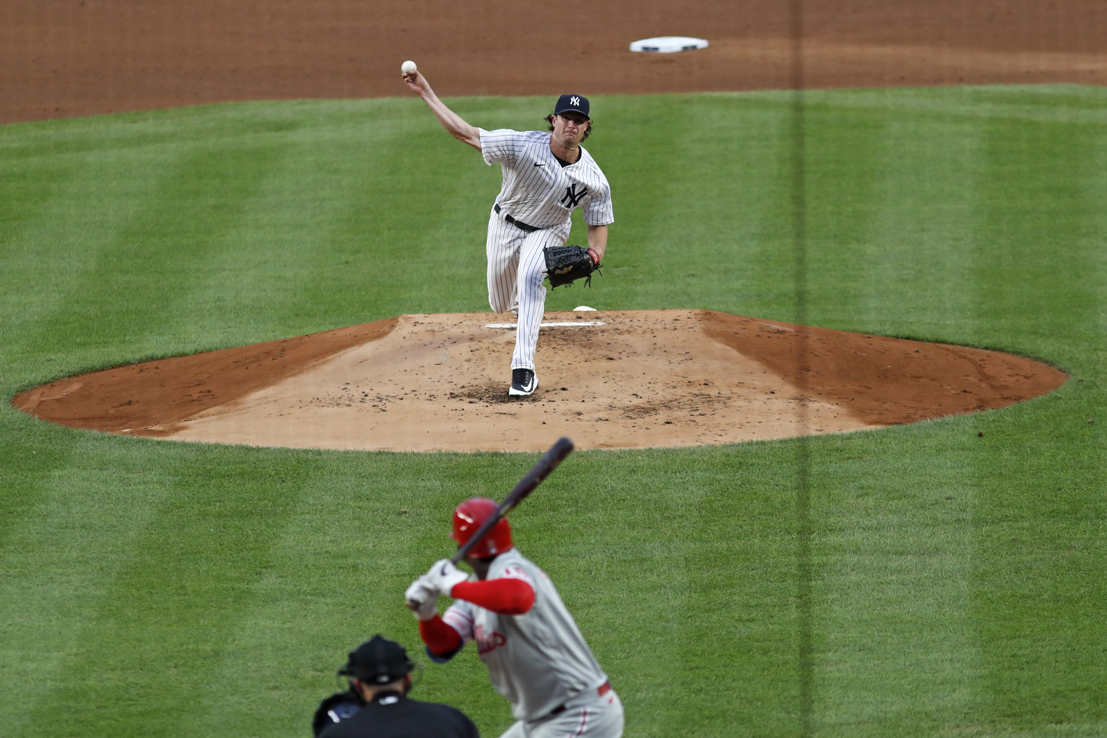 New York Yankees starting pitcher Gerrit Cole delivers to Philadelphia Phillies Didi Gregorius during the second inning of a baseball game, Monday, Aug. 3, 2020, at Yankee Stadium in New York. (AP Photo/Kathy Willens)