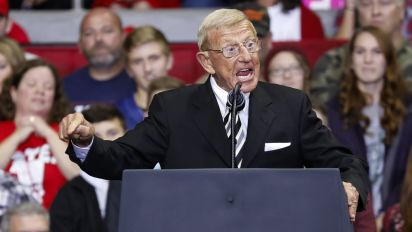Holtz compares college football to D-Day