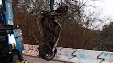 Diver finds motorcycles, guns, and more under sketchy bridge