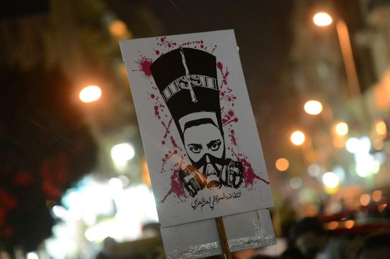 A protester at a 2013 rally in Cairo holds a placard pledging an 'uprising of women in the Arab world' (AFP Photo/Khaled DESOUKI)