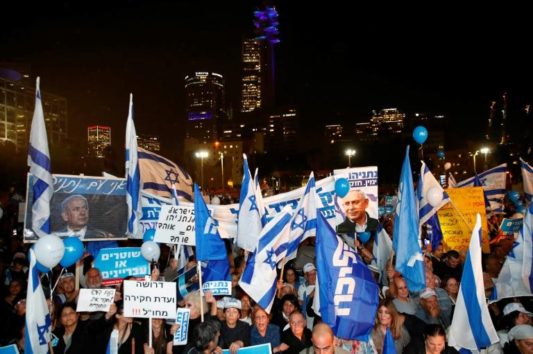 "Supporters of Israeli Prime Minister Benjamin Netanyahu took to the streets of Tel Aviv last month to protest what they labelled a ""coup"" against him (AFP Photo/Jack GUEZ)"