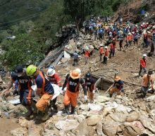 Philippine miners dig for their own in typhoon landslide