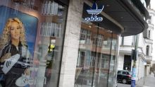 Adidas stops 1 billion euros share buyback