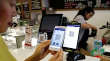 New York City and New Jersey lawmakers target cashless businesses, alleging bias against the poor