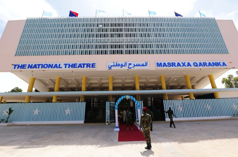 Somali military officers are seen outside a renovated Somalia's National Theatre in Mogadishu
