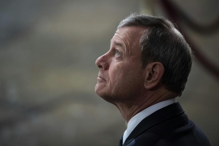 John Roberts awaits the arrival of the body of former US president George H.W. Bush at the US Capitol in December 2018