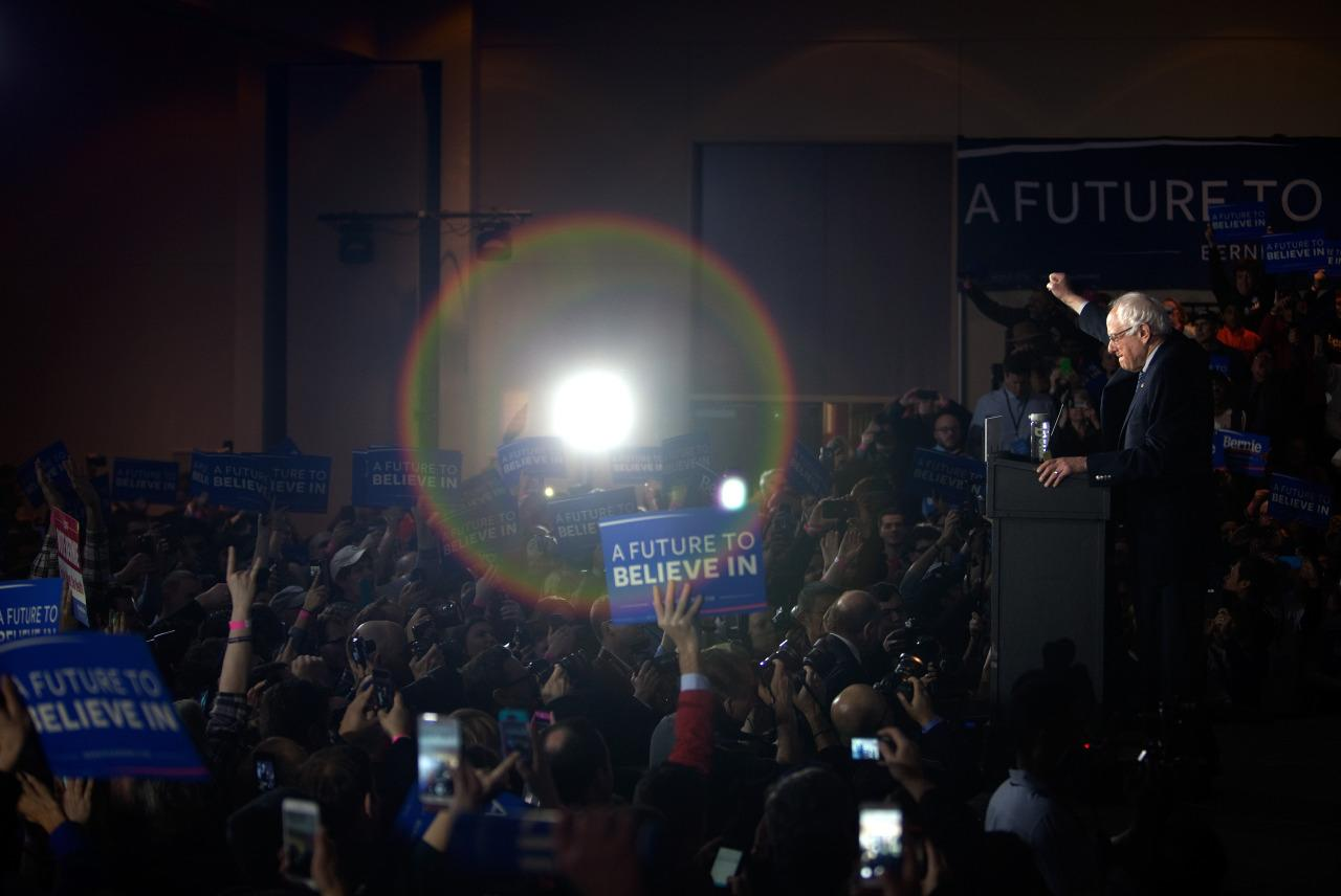 <p>Democratic presidential candidate Bernie Sanders greets supporters at his caucus-night party after a close race in the Iowa caucuses Monday night in Des Moines, Iowa.<i> (Photo: Khue Bui for Yahoo News)</i></p>
