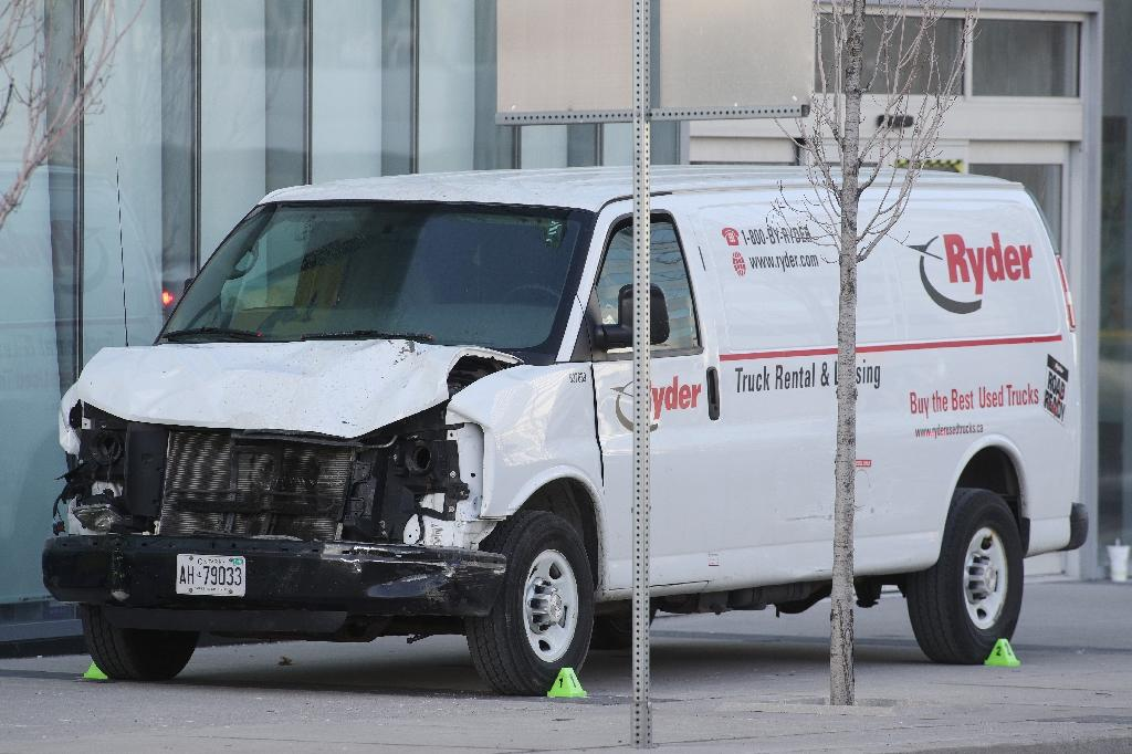 The van used to hit pedestrians, killing 10, in Toronto, Ontario, on Monday on April 23, 2018 (AFP Photo/Lars Hagberg)