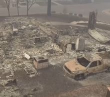 Crane operator fired for taking insensitive photos on properties torched by Camp Fire