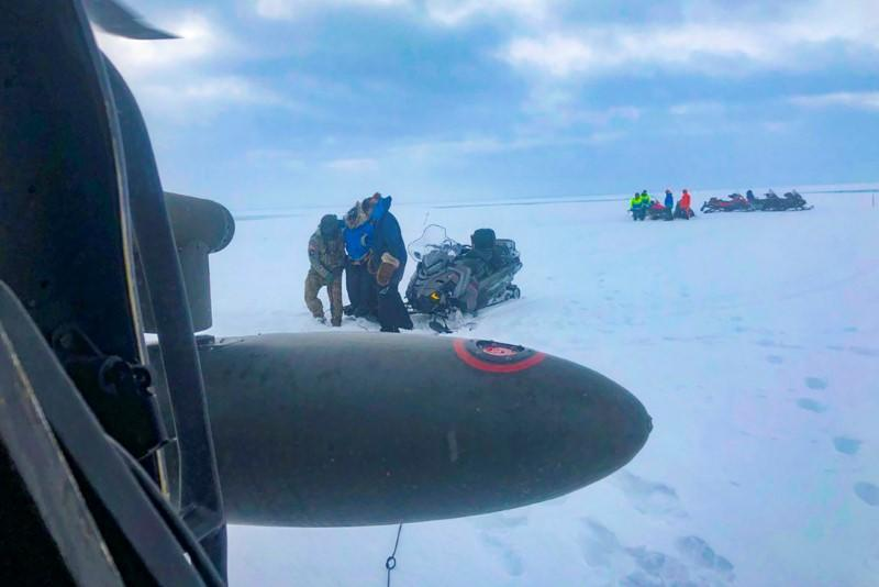 Three mushers from the Iditarod dog sled race are rescued by an aircrew of an Alaska Army National Guard near Nome