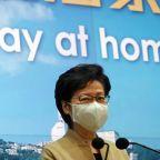 Stay at home, Hong Kong leader urges as COVID-19 surges anew