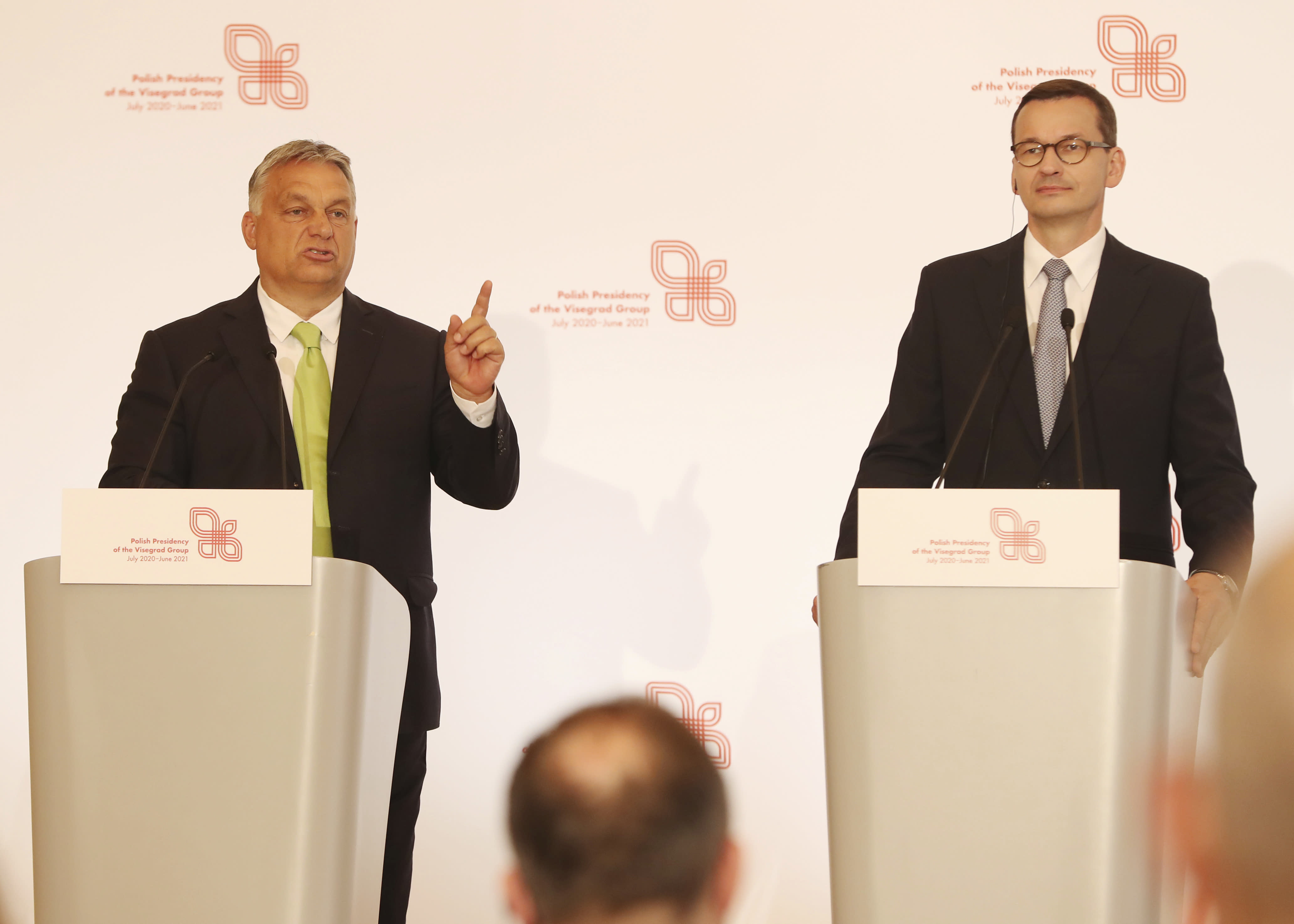 Hungarian Prime Minister Viktor Orban,left, speaks at a join news conference with Poland's Prime Minister Mateusz Morawiecki,right, following talks of government leaders of the Visegrad Group of regional cooperation that also includes the Czech Republic and Slovakia, in Warsaw, Poland, on Friday, July 3, 2020. Poland, which took the group's 12-month rotating presidency, is seeking a generous EU budget to help the region recover from the coronavirus pandemic.(AP Photo/Czarek Sokolowski)