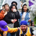 Crowds gather at Staples Center to mourn Kobe Bryant as Grammys red carpet unfolds just feet away