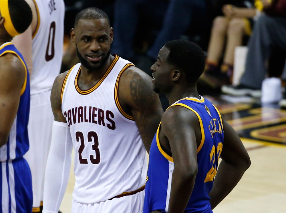 LeBron James and Draymond Green talk. They like talking. (AP)