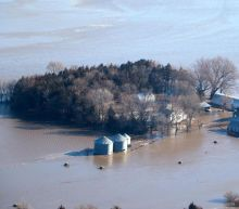 US weather: States reel from historic floods as fresh snow threatens parts of the midwest