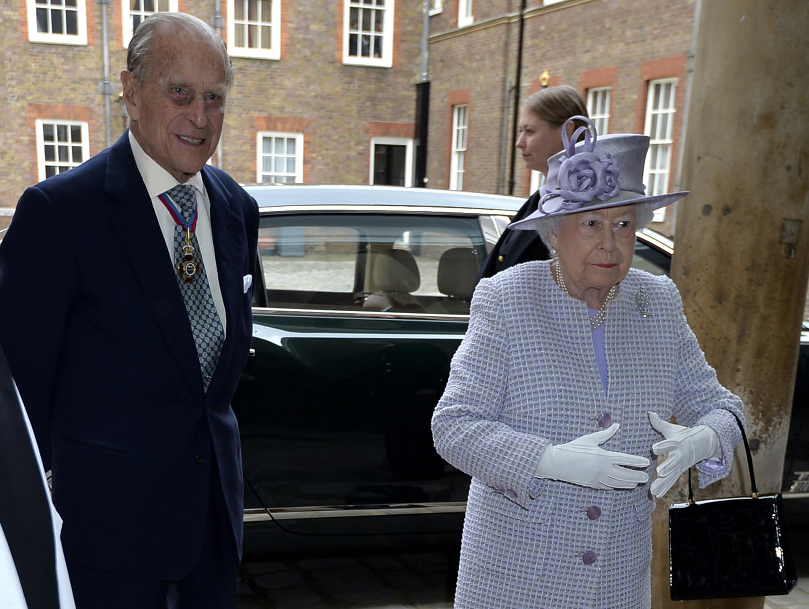 Britain's Queen Elizabeth, right, and  Prince Philip, the Duke of Edinburgh arrive at Chapel Royal in St James's Palace, London, for an Order of Merit service, Thursday May 4, 2017. Prince Philip, the consort known for his constant support of his wife Queen Elizabeth II as well as for his occasional gaffes, will retire from royal duties this fall, Buckingham Palace said Thursday. (John Stillwell/Pool Photo via AP)