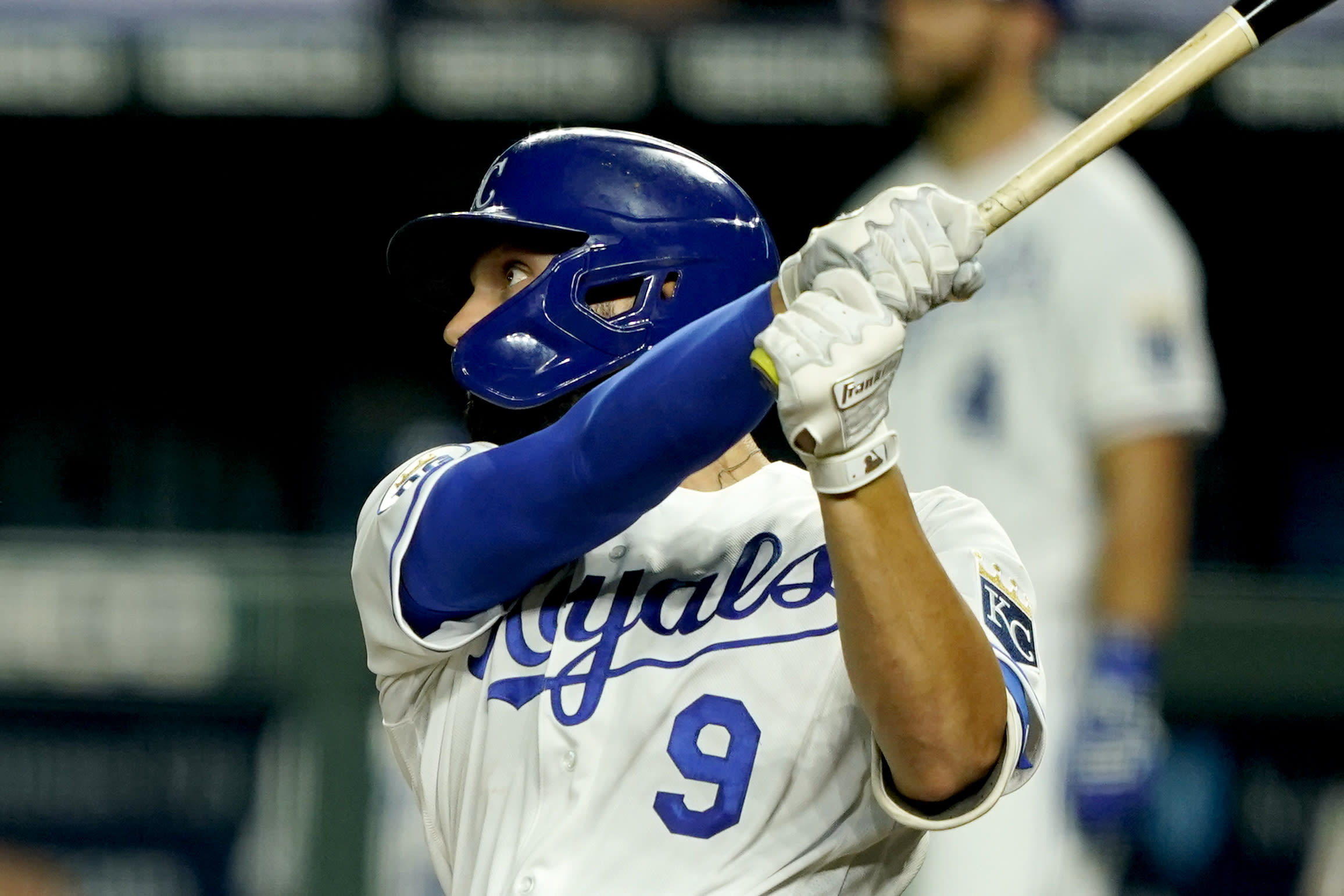 Kansas City Royals' Ryan McBroom hits a solo home run during the sixth inning of a baseball game against the Chicago White Sox Friday, July 31, 2020, in Kansas City, Mo. (AP Photo/Charlie Riedel)