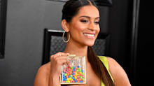 Lily Singh walked the Grammys red carpet with nothing but Skittles in her bag