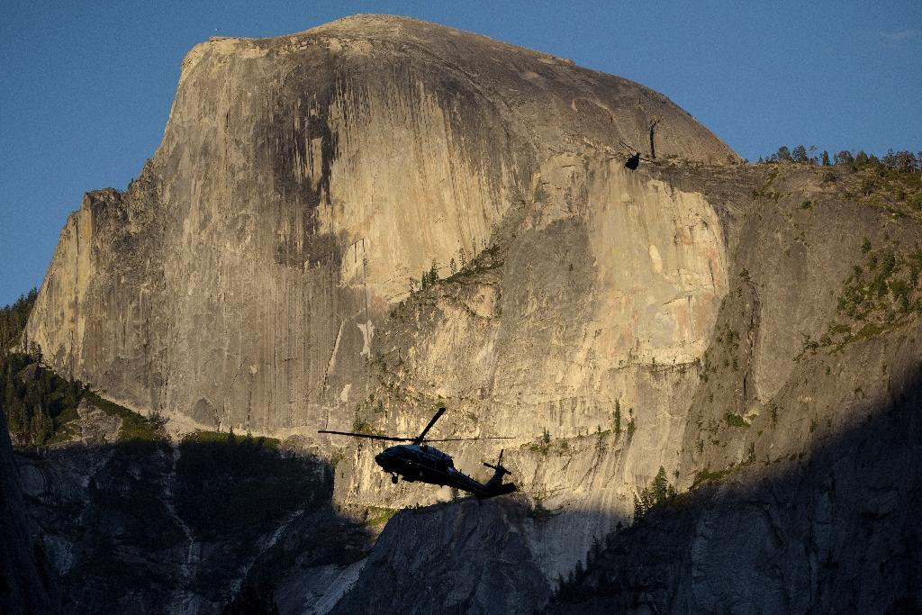 Marine One -- carrying the US first family -- flies past 'Half Dome' at the Yosemite National Park (AFP Photo/Brendan Smialowski)