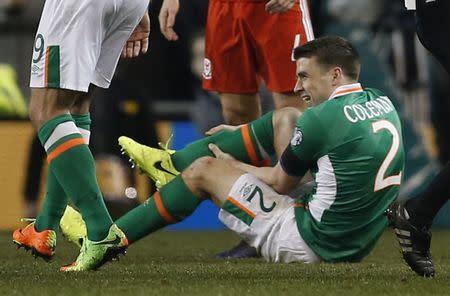 Republic of Ireland's Seamus Coleman lies injured