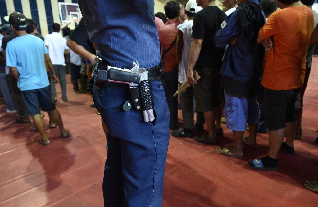 Philippine police have been accused of murdering people for their own gain and organising anonymous vigilante death squads (AFP Photo/Ted Aljibe)