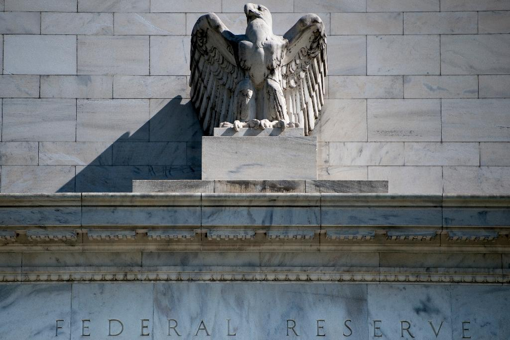 The Federal Reserve announced the results of its annual bank stress tests, showing the 18 largest financial institutions would suffer losses but still have enough of a capital buffer to continue operating (AFP Photo/Brendan Smialowski)