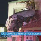 Car soars into second floor of Santa Ana building in bizarre crash; 2 hurt
