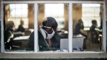 Virus surge sparks SAfrica curfew and Spain local lockdown