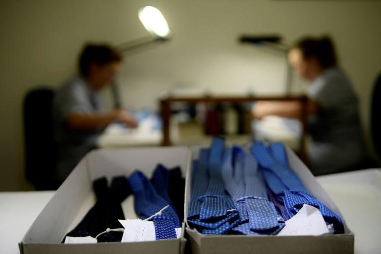 The silk is still hand-printed in Macclesfield, England, and the ties themselves are sewn by hand in a workshop close to the boutique, which employs 20 seamstresses (AFP Photo/FILIPPO MONTEFORTE)