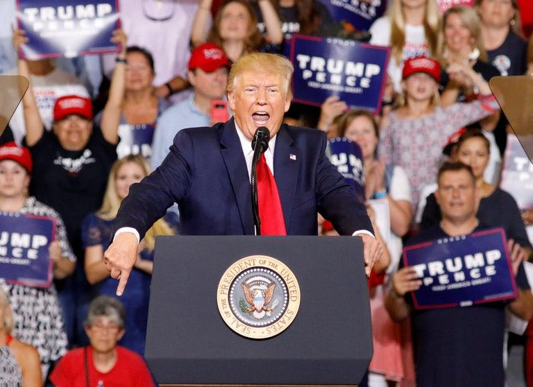 """Donald Trump again used racist tropes in a renewed attack on four Democratic congresswomen at a campaign rally on Wednesday night, leading his supporters to chant """"Send her back! Send her back!"""" in reference to the US citizen Ilhan Omar.The president used the North Carolina rally to resume his row with the self-styled """"squad"""" of congresswomen that also includes Alexandria Ocasio-Cortez, and which began when he tweeted that the four should """"go back"""" to their home countries.All four are people of colour and US citizens. Three were born in the US, while Ms Omar came to the country as a refugee from Somalia when she was 12.Referring to the women, Mr Trump said: """"Tonight I have a suggestion for the hate-filled extremists who are constantly trying to tear our country down.""""They never have anything good to say. That's why I say, 'Hey if you don't like it, let 'em leave, let 'em leave'.""""Taking the politicians on one at a time, Mr Trump ticked through a list of what he deemed offensive comments by each woman, misconstruing many facts along the way. Ayanna Pressley of Massachusetts and Rashida Tlaib of Michigan complete the four.Ms Omar came under the harshest criticism as Mr Trump played to voters' grievances, drawing the sustained """"send her back"""" chant.Before he left Washington, Mr Trump said he has no regrets about his ongoing row with the four. The president told reporters he's """"winning the political argument"""" and """"winning it by a lot"""".""""If people want to leave our country, they can. If they don't want to love our country, if they don't want to fight for our country, they can (leave),"""" Mr Trump said. """"I'll never change on that.""""His speech was filled with criticisms of the news media, which he says sides with liberals, and of special prosecutor Robert Mueller's Russia probe. Mr Mueller had been scheduled to testify to Congress on Wednesday, but it was postponed.He also talked about illegal immigration, a main theme of his first presidential bid that is taking centre stage i"""